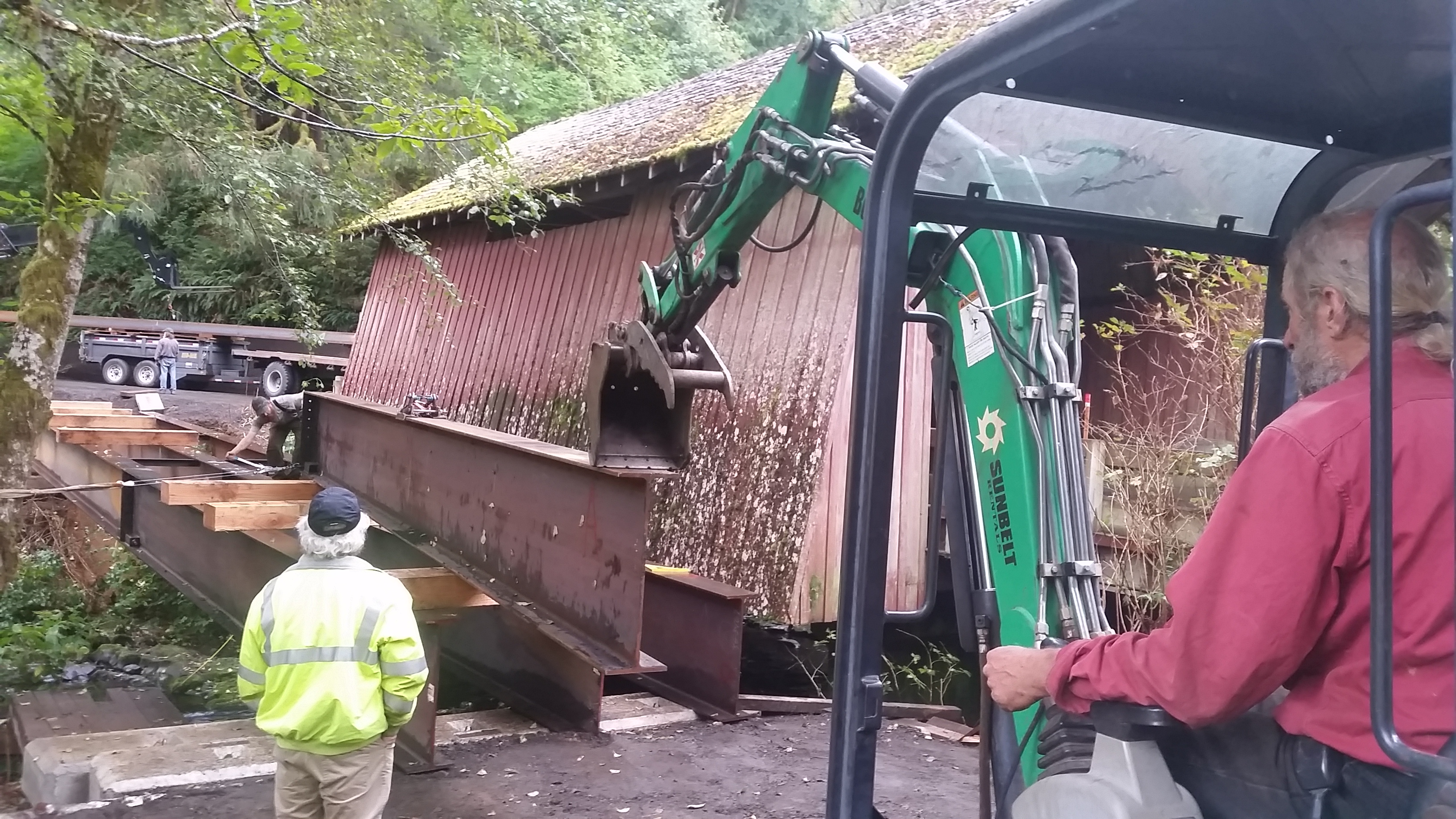 Bruce Maederer setting steel I-Beams for the Yachats Covered Bridge Restoration